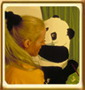 Allex Michael, an attractive young woman with long blond hair painting a panda.